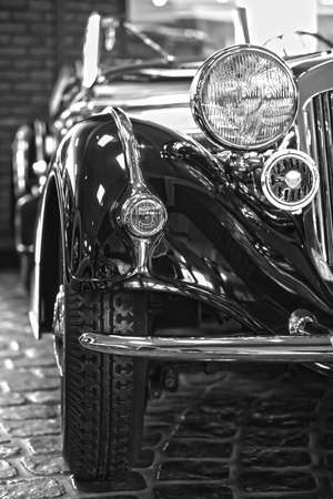 part of a retro car 30s,  black and white photo
