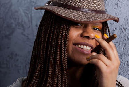 close-up portrait of a black young woman with a cigar Stock Photo