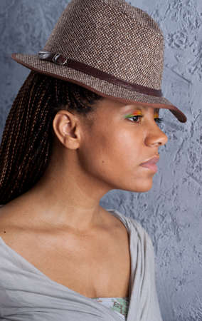 profile portrait of yong woman in a hat photo