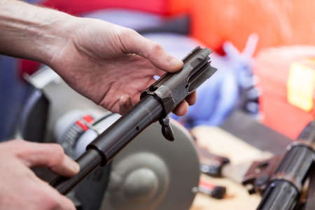 repair of the old German submachine gun MP-38. details in the hands of a master gunsmith 版權商用圖片