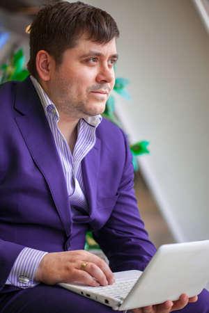 businessman with laptop ponders Deal Stock fotó