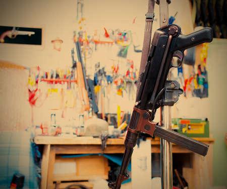 MP38 sub machine gun in the interior restoration workshop. image retro style