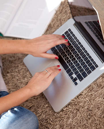 Female hands typing on a keyboard Stock Photo