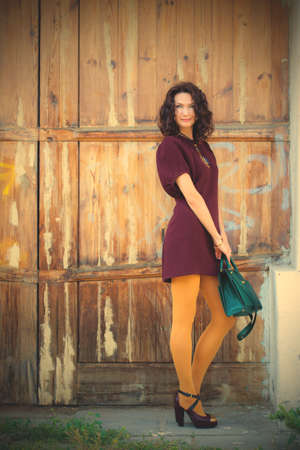 beautiful brunette middle age near the old door.