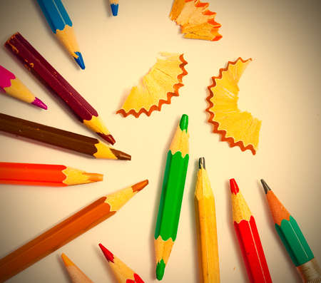 set of a vintage colored pencils with shavings on the white background.  image retro styke