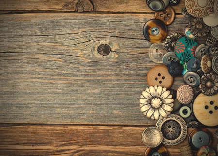 vintage buttons on aged table. close up.