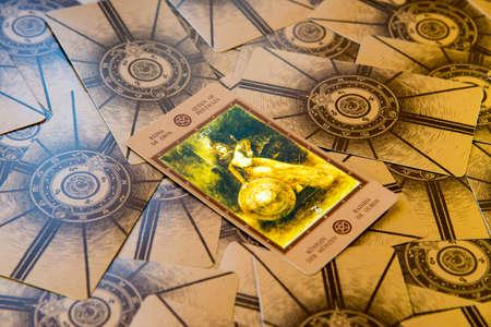 cartomancy: Tarot card Qeen of Pentacles. Labirinth tarot deck. Esoteric background. Editorial