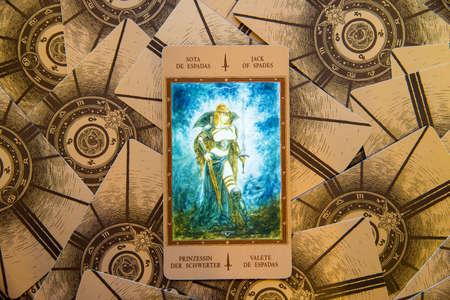cartomancy: Tarot card Jack of Spades. Labirinth tarot deck. Esoteric background.
