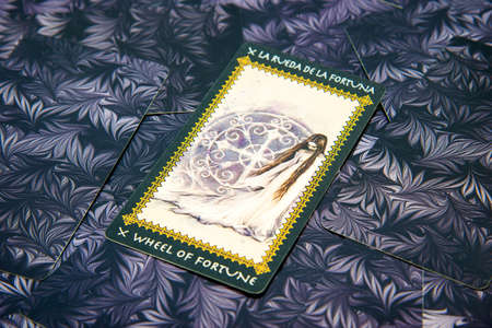 cartomancy: Tarot card Wheel of Fortune. Favole tarot deck. Esoteric background.