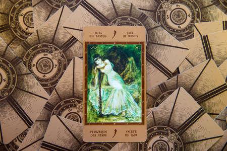 Moscow, Russia - January 29, 2017: Tarot card Jack of Wands. Labirinth tarot deck. Esoteric background