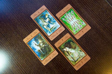 cartomancy: Tarot cards on the wood. Labirinth tarot deck. Esoteric background. Editorial