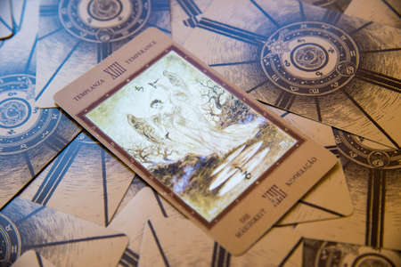 cartomancy: Tarot card Temperance. Labirinth tarot deck. Esoteric background.