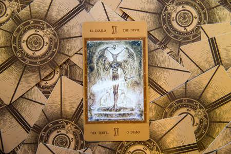 cartomancy: Moscow, Russia - January 29, 2017: Tarot card The Devil. Labirinth tarot deck. Esoteric background