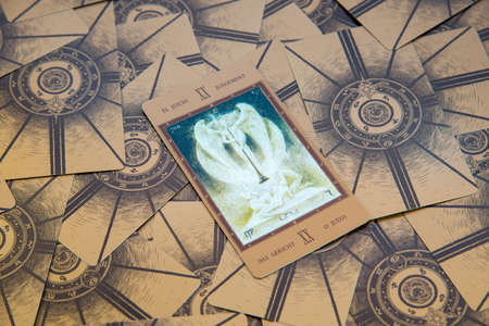 cartomancy: Moscow, Russia - January 29, 2017: Tarot card Judgement. Labirinth tarot deck. Esoteric background
