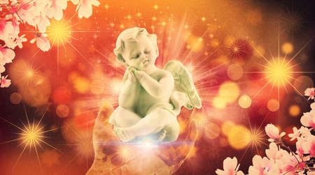 Peaceful baby angel on an abstract colorful and powerful hand of god giving him to the world Stockfoto