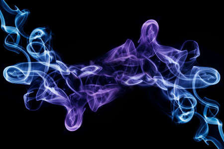Abstract multicolored smooth and soft smoke effect on a black background Standard-Bild