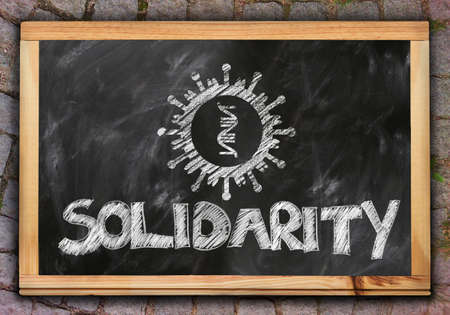 Artistic 3d illustration of the word solidarity on a black board