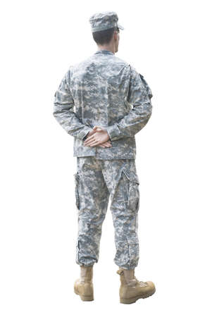 Army soldier in camouflage uniform in parade rest position isolated Stock Photo