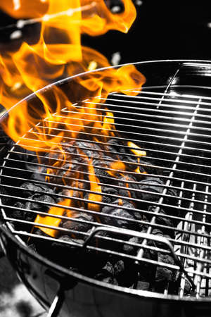 Black and white orange grill fire Stock Photo