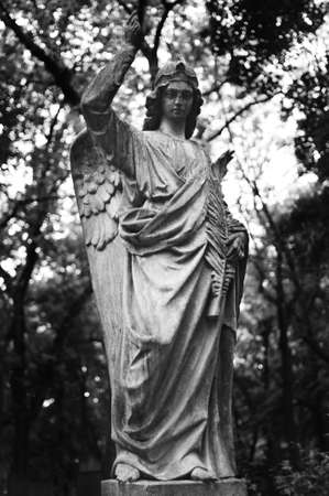 Statue of an angel on the Prague cemetery photo