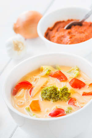 Thai soup Tom Kha Gai with chicken and red curry photo
