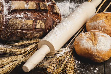 bakery products: Still life with bread,wheat, flour and rolling-pin
