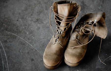 army boots: US Army boots on the scratched grey floor
