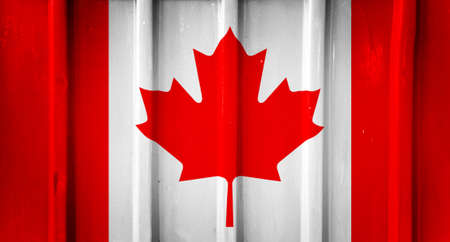 Grunge canadian flag background painted on the metal fence photo
