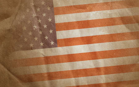 Vintage bent faded paper american flag at angle photo