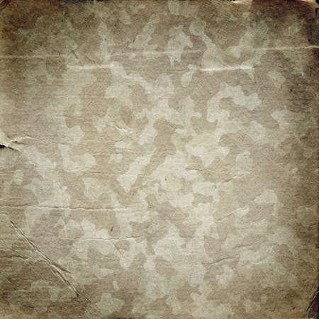 Grunge militaire achtergrond. Camouflage patroon op een papier textuur Stockfoto
