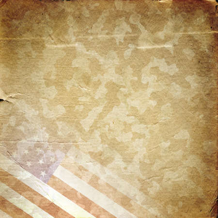 Grunge military background. American flag over desert camouflage pattern