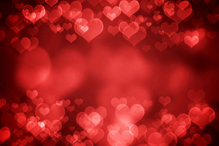 Red  glowing heart shaped bokeh for Valentines day  background photo