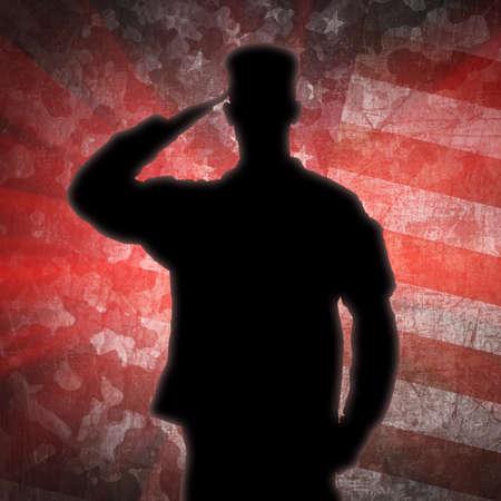 グリーン陸軍迷彩背景に兵士のシルエットに敬礼