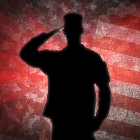 armed services: Saluting soldiers silhouette on a green army camouflage background Stock Photo
