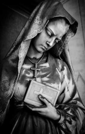 monumental cemetery: Black and white photo of a tombstone statue on Staglieno cemetery, Genoa, Italy Stock Photo