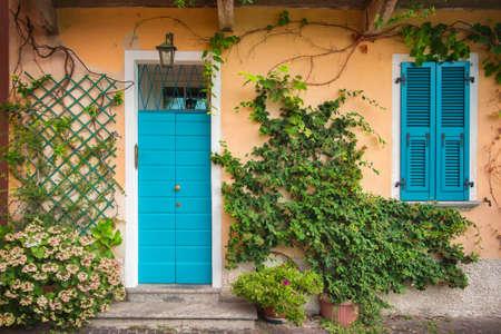 bellagio: Colorful door and shutters. Mandello del Lario,Lake Como, Italy Stock Photo
