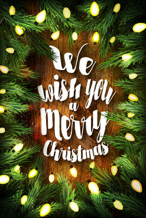 pine wreath: Typographic Christmas card  with pine wreath and holiday greetings on wooden background. We wish you a Merry Christmas Stock Photo