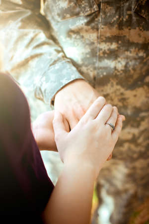 homecoming: Married military couple holding hands Stock Photo