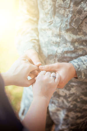 returning: Married military couple holding hands Stock Photo