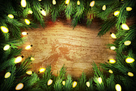 pine wreath: Christmas pine wreath  with lights on wooden background. Copyspace for  your text