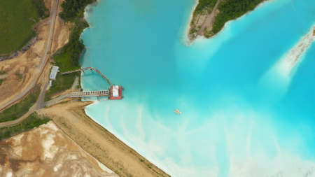 Artificial lake for discharging chemical waste from a chemical plant. Environmental pollution. Ecological catastrophy. Aerial shot . Beautiful view. Banque d'images