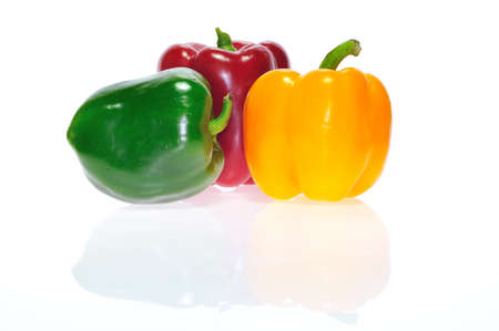 Red peppers, green and yellow isolated. Stock Photo