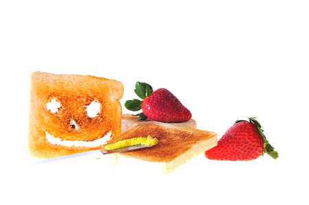 childhood obesity: Toast bread and strawberries for breakfast. Stock Photo