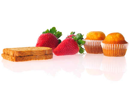 childhood obesity: Whole wheat bread, pastries and fruit isolated.