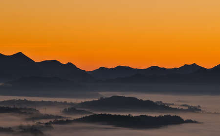 climatology: Sunrise on the mountain in fog. Stock Photo