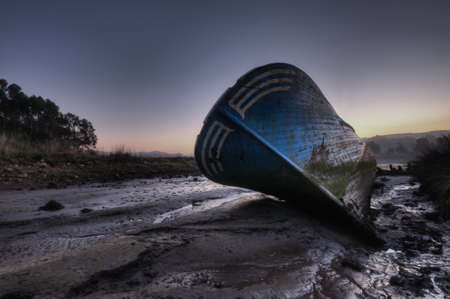 defects: Beached boat. Stock Photo