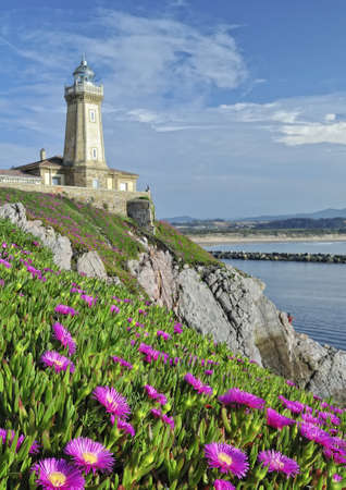 lighthouse keeper: Lighthouse on the coast.