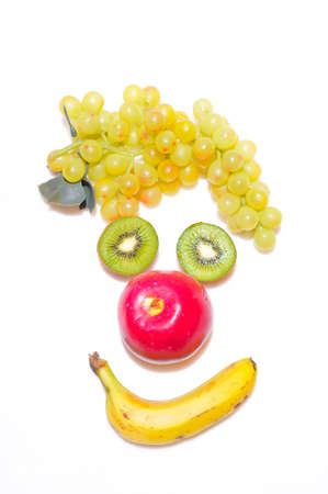 eating banana: Funny Face made ​​with fruit. Stock Photo