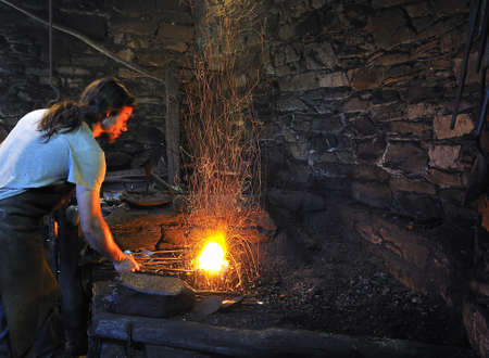 ancient blacksmith: Mazonovo, Asturias, Spain - August 13, 2011 - Blacksmithing of Mazonovo.