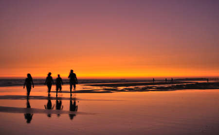 walk on the beach at sunset.